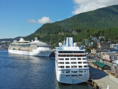 Two large cruise ships at anchor in the colourful port of Ketchikan