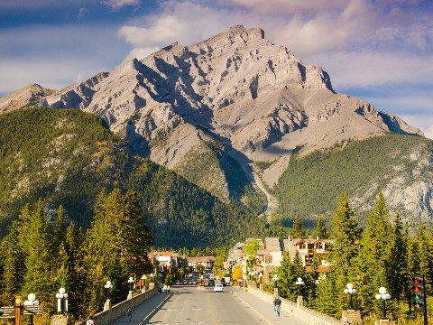 View of Banff town with large triangular mountain in the background