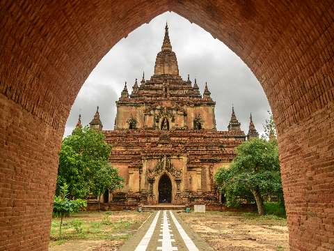 View through arch of the large stone Buddhist temple of Htilominlo in Burma