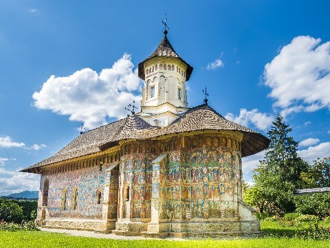 Church decorated with religious frescoes in Bucovina, Romania