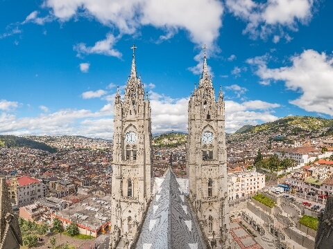 Two towering stone spires of the Basilica del Voto Nacional in Quito