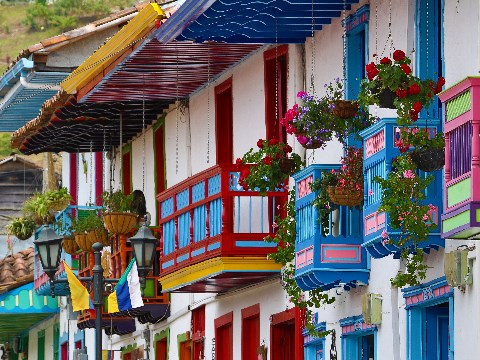 White-washed colonial homes with colourful balconies and hanging flower baskets in Salento, Colombia