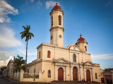 Colonial peach edifice of church in Cienfuegos, Cuba