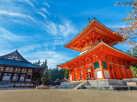 Bright red pagoda with tiered roof in Koyasan, Japan