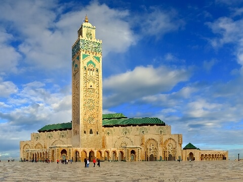 Distinctive square minaret and green roof of Great Mosque in Casablanca