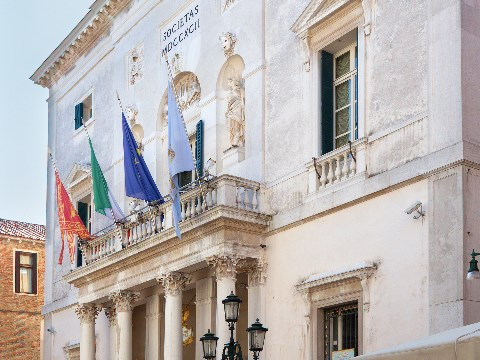 Venice opera house with Italian flag flying outside