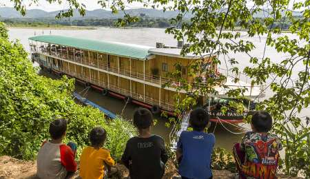 Local children at river bank with Pandaw river cruise boat