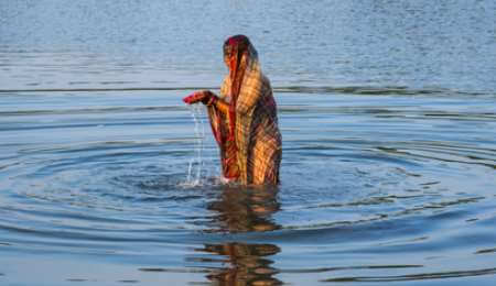 Local women praying the holy Ganges River